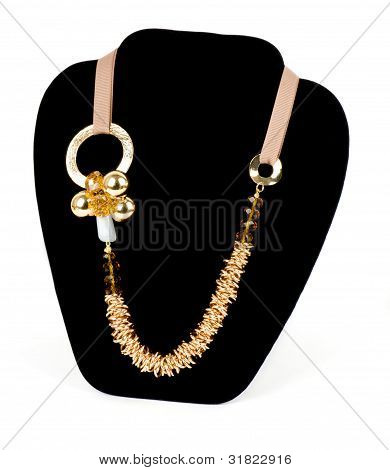 Gold jewelry (necklace) on a black background