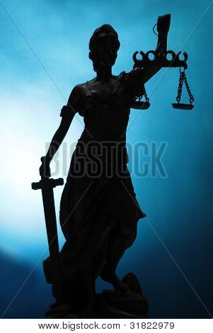 Silhouette Lady of Justice on blue background