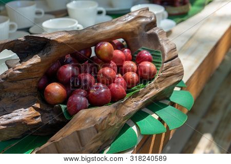 This Is Thailand Red Plum. It Is Sour And Astringent. It Is In The Art Wood Basket On The Wood Count