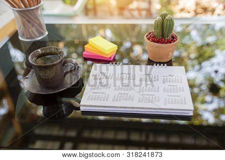 Desktop Calendar Pages 2020 On Table With Boke Background For Planner Work On Organization,managemen