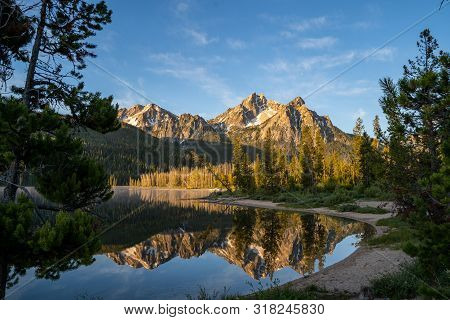 Sunrise At Stanley Lake In Idaho. Calm Water With Mountain Reflection
