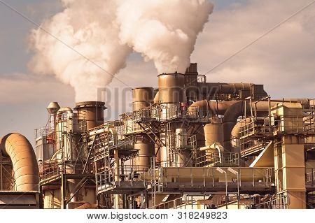 Smoking Chimneys Pipes And Silos Of A Chemical Complex Of A Factory