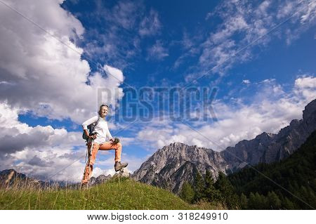 Woman Hiker Hiking Looking At Scenic View Of Mountain Landscape . Adventure Travel Outdoors Person S
