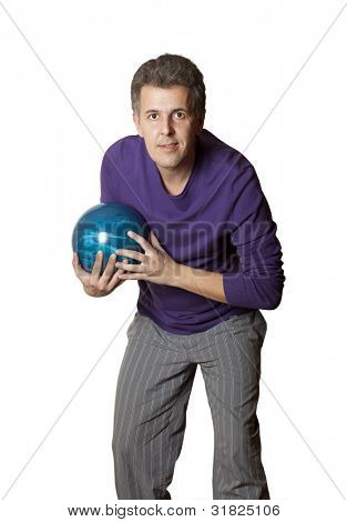 Adult man holding a bowling ball