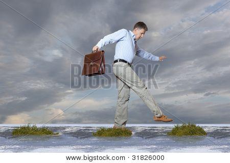 The businessman walks on a bog