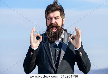Alright Gesturing. Man Bearded Optimistic Businessman Wear Formal Suit Sky Background. Success And L