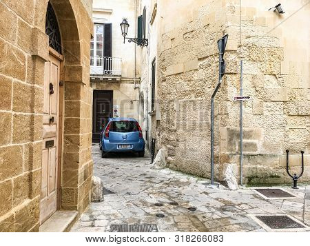 Lecce, Italy - October 26, 2016: Typical Narrow Street In Italian Towns With A Car Parked Near The H