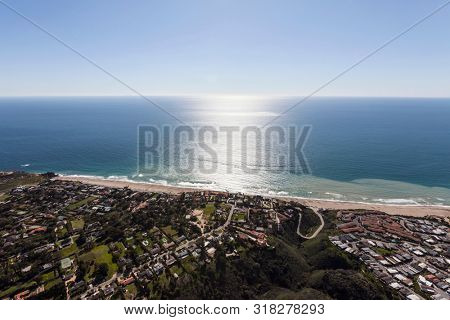 Afternoon aerial view of pacific ocean view homes above Zuma Beach in scenic Malibu, California.