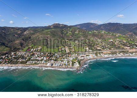 Aerial view of choreline homes and Lechuza Beach in Malibu, California.