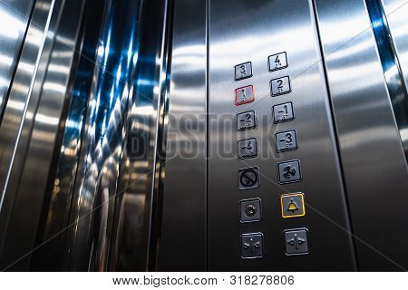 Elevator Buttons For Disabled Blind People With Braille Language Signs On Panel, Close Up