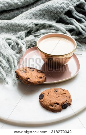 Beautiful Enameled Cup Of Coffee With Cookies And Knitted Blanket