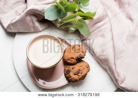 Beautiful Enameled Cup Of Coffee With Cookies And Silk Cloth