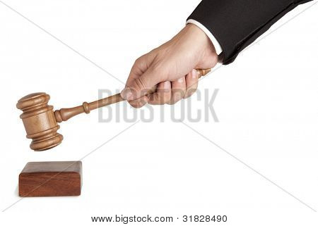 Human hand holding a wooden gavel isolated