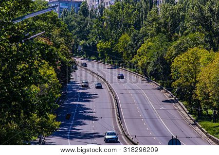 Urban Multi-lane Road With Moving Cars. Transport.