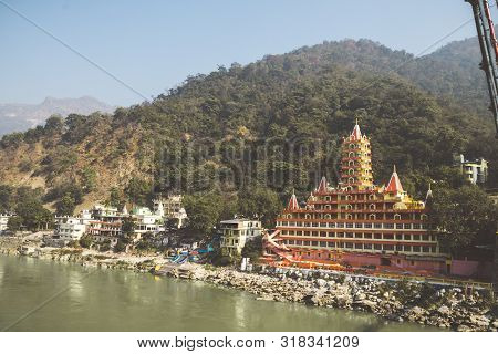 Rishikesh India. 10 January 2018. View Of Ganga River Embankment, Lakshman Jhula Bridge And Tera Man