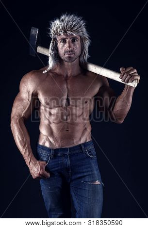 Success. Man With Sexy Bare Torso In Jeans. Strong Bodybuilder With Sexy Bare Torso. Man In Hat With