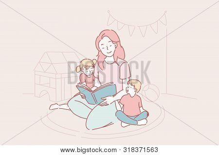 Mother S Day, Kindergarten, Motherhood Concept. A Young Mother Reads Fairy Tales To Her Son And Daug