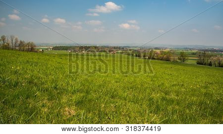 Springtime Rural Scenery With Meadows, Fields, Forest And Dispersed Settlement From Road Above Komor