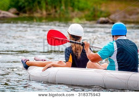 Rafting Trip. Father And Child Rafting On The River In A Rubber Inflatable Boat. The Concept Of A Fr