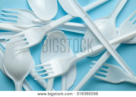 Plastic Cutlery, Forks, Spoons And Knives. Pollution Of The Environment With Plastic And Microplasti