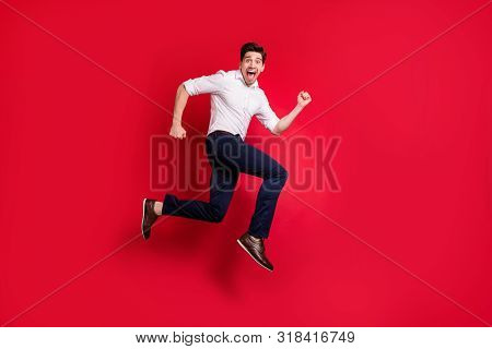 Full Length Body Size Photo Of Quickly Running Man Hurrying Up Urgently While Isolated With Red Back