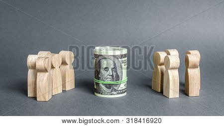 Two Groups Of People Are Divided By A Bundle Roll Dollars. Investment Concept. High Profits And A We