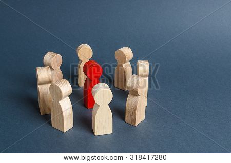 Red Human Figure Surrounded By A Circle Of People. Leader Boss And Leadership. Cooperation And Teamw