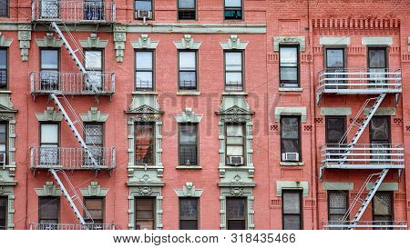 Red Brick Facade, And Fire Stairs. Harlem, Nyc.