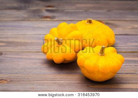 Three Fresh Squash On Wooden Background. Rustic Style