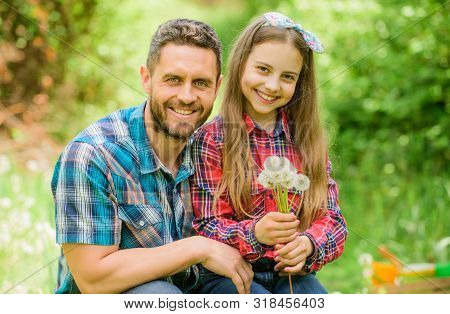 Father and little girl enjoy summertime. Dad and daughter blowing dandelion seeds. Keep allergies from ruining your life. Seasonal allergies concept. Outgrow allergies. Happy family vacation poster