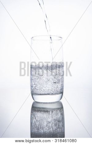 The Glass Beaker Is Filled With Clear Transparent Mineral Water.