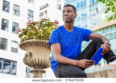 Modern Reading. Young African American College Student Studying In New York, Wearing Blue T Shirt,