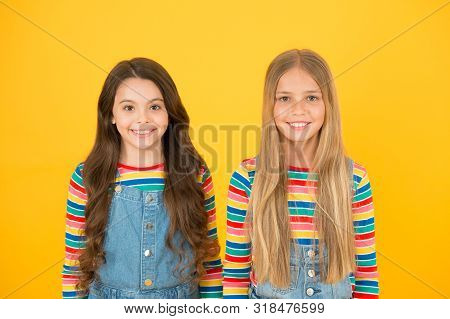 Long hair best female adorn. Girls blonde and brunette shiny healthy hair. Grow hair. Hairdresser salon. Kids beautiful friends or sisters with perfect hairstyles. Chevelure concept. Natural beauty. poster