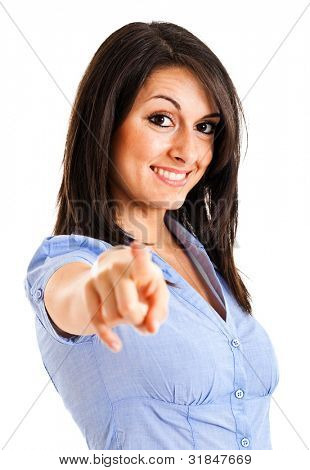 Portrait of a young smiling businesswoman pointing at you. Isolated on white poster