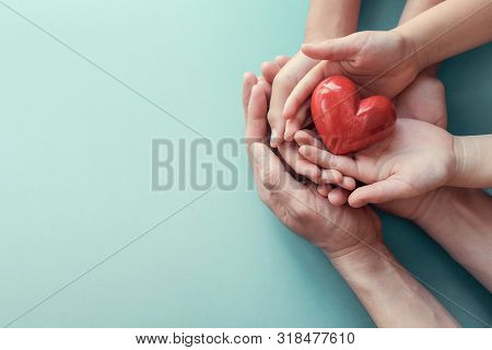 Adult And Child Hands Holding Red Heart On Aqua Background, Heart Health, Donation, Csr Concept, Wor