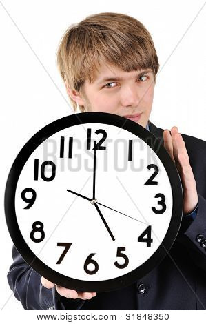 Handsome teenage huy holding clock in his hands poster