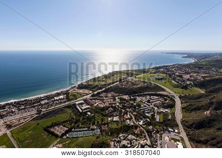 Aerial view of pacific ocean view homes near Malibu Canyon Road in Malibu, California.