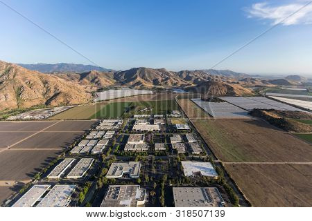 Aerial view of industrial buildings and farm fields near Camarillo in scenic Ventura County, California.