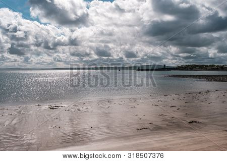 Carrigaholt Beach And Castle In Ireland