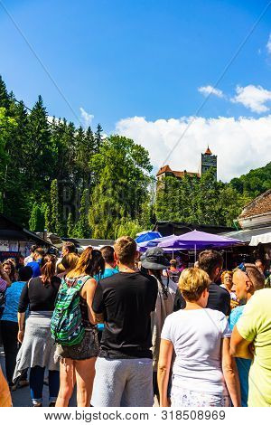 Bran, Romania – 2019. People On Their Way To Bran Castle (castelul Bran). Legendary Historical Castl