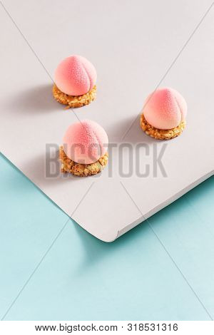 Peach Cupcakes In The Shape Of Peaches On A Cracker