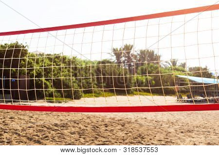 Volleyball Net On A Tourist Beach. A Volleyball Net Is Stretched On A Sandy Beach.