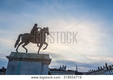 Roi Louis Xiv Statue On Display On The Place Bellecour Square, In Downtown Lyon, France, With The Ba