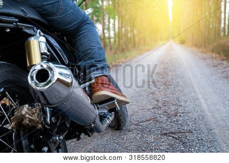 Motorcycle Driver Riding Alone On Road. Empty Road On A Motorcycle Tour Journey. Traveling, Speed An