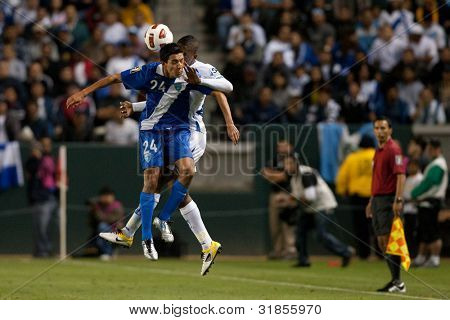 CARSON, CA. - JUNE 6: Guatemala player  M Jonathan Lopez #24 (front) & Honduras D Brayan Beckeles #24 (back) during the 2011 CONCACAF Gold Cup group B game on June 6 2011 at the Home Depot Center in Carson, CA.