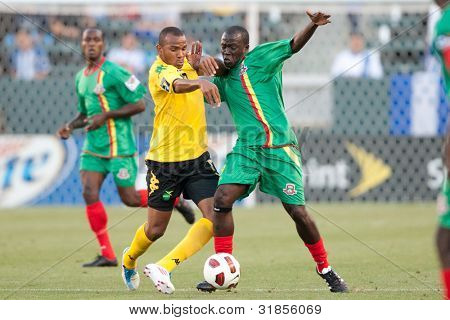 CARSON, CA. - JUNE 6: Jamaica M player Rodolph Austin #17 (L) and Grenada M player Patrick Modeste #19 (R) during the 2011 CONCACAF Gold Cup group B game on June 6 2011 at the Home Depot Center in Carson, CA.