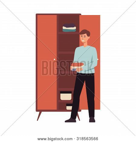Happy Man Organising Clothes In A Closet, Young Male Cartoon Character Standing Beside Wardrobe