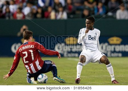 CARSON, CA. - JUNE 1: Chivas USA M Ben Zemanski #21 (L) & Vancouver Whitecaps FC M Gershon Koffie #28 (R) during the MLS game on June 1, 2011 at the Home Depot Center in Carson, CA.