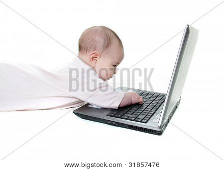 baby with laptop over white