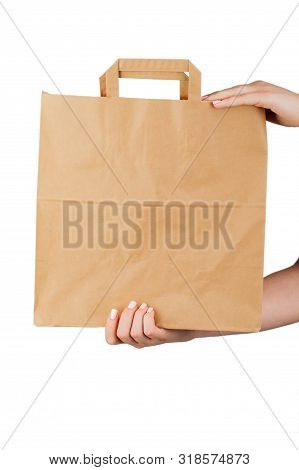 Close-up Of Woman Holding Brown Empty Paper Bag Isolated On White Background. The Concept Of Service